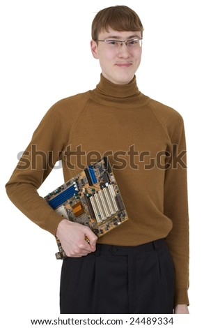 Young man in spectacles holding motherboard on hand