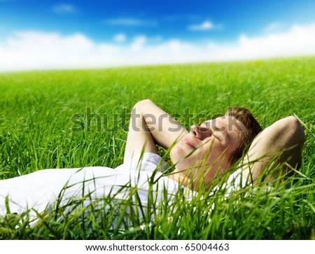 young man in spring grass - stock photo