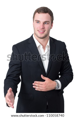 Young man in suit shaking hand