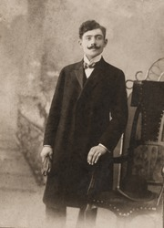 young man in the coat, vintage photo