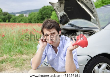 young man in trouble with his car
