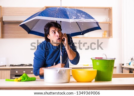 Young man in water leakage from the neighbors concept Foto stock ©