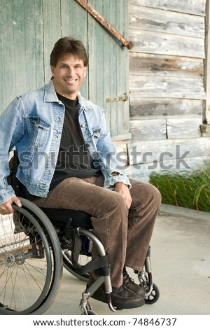 young man in wheelchair, smiling