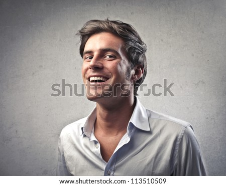 Young man in white shirt smiling