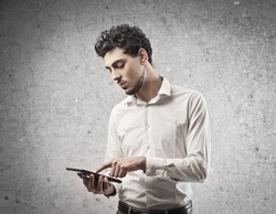 Young man in white shirt using a tablet PC
