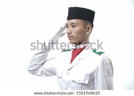 young man Indonesian National Flag Hoisting Troop salutes isolated on white. National Paskibraka Council.