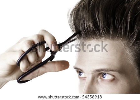 Young man is going to cut his beautiful long hairs - stock photo