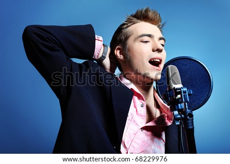 Young man is singing rock'n'roll.