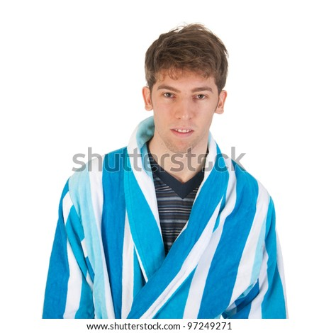 Young man is wearing pajamas and morning gown