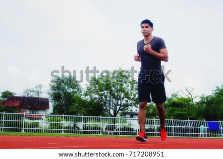 young man jogging in the...