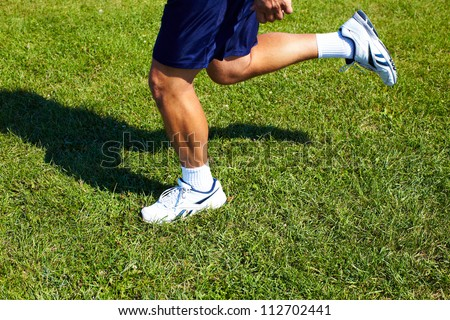 Young man jogging in the park. Health and fitness.