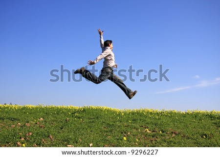 Young man jumping in a beautiful landscape