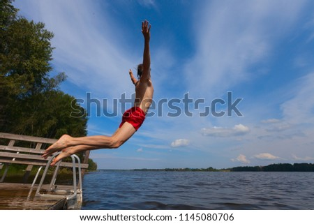 Young man jumping into water, summer time - Shutterstock ID 1145080706