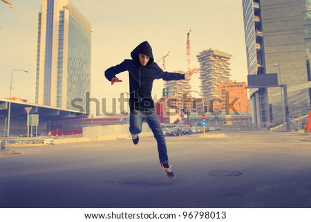 Young man jumping on a city street