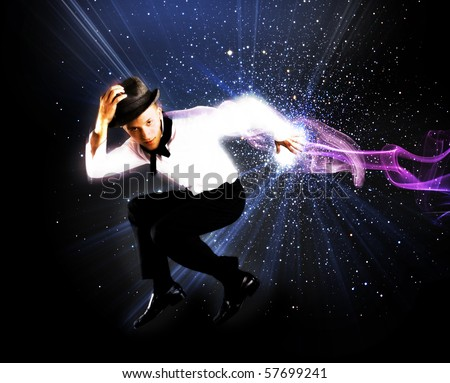 Young man jumping on abstract background - stock photo