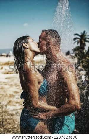 Young man kisses his beautiful girlfriend. Just one kiss. Kissing. Couple in love. Love story. Travel. Vacation.  #1287823690