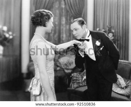 Young man kissing an elegant woman's hand