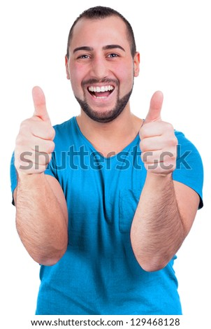 Young man laughing raises two thumbs in the air