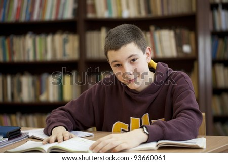 Young man learning in library