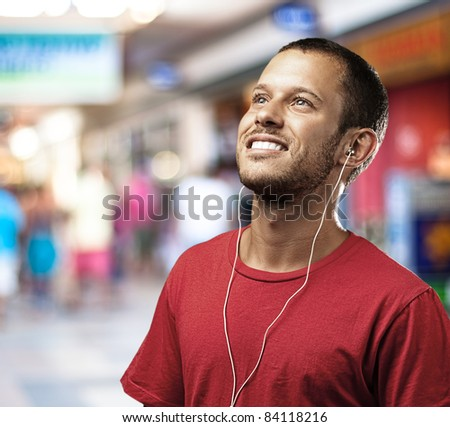 young man listen to music at shopping center
