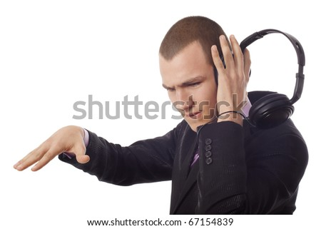 Young man listening and filling music at headphones