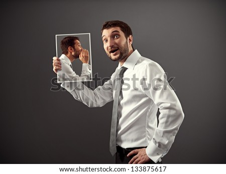 young man listening his inner voice with interest