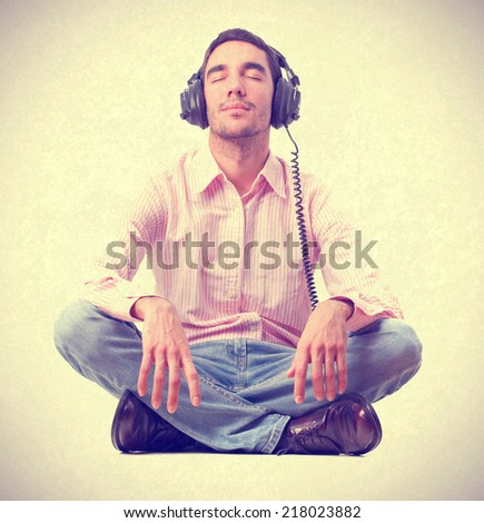 young man listening music by headphones.