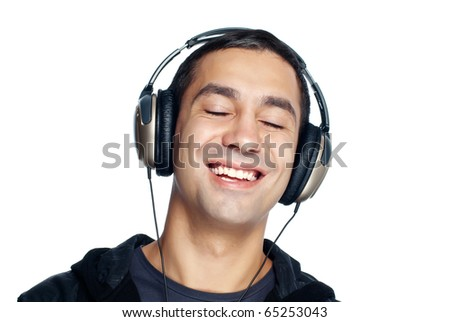 Young man listening music. Isolated on white background.