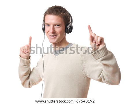 young man listening music with headphones isolated over white background
