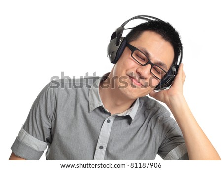 Young man listening to music. Isolated on white background.