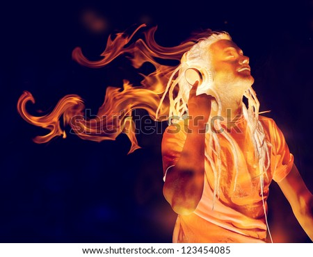 Young Man Listening to Music on Headphones in Flames