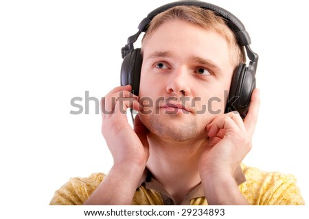 Young man listens to beautiful music. - stock photo