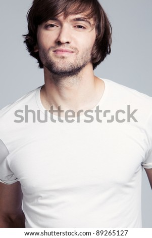 young man long hair in white t-shirt portrait