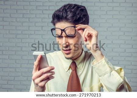 Young man looking at mobile phone