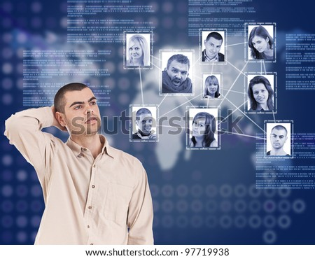 young man looking at social network structure in digital futuristic blue background