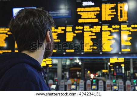 young man looking at train...