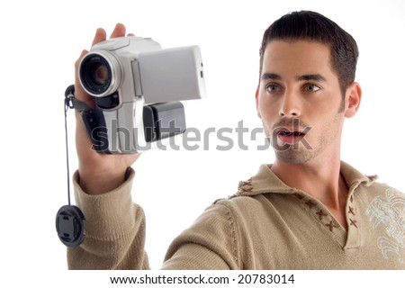 young man looking in to video from handy cam on an isolated white background