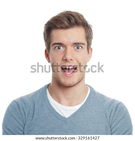 young man looking pleasantly surprised with open mouth #329161427