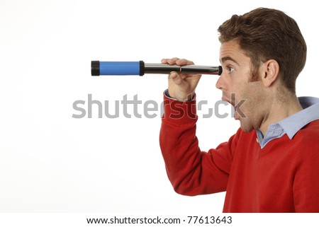 young man looking through a telescope