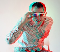 young man, looking through stereo glasses (anaglyph effect. need stereo glasses to view in 3D)