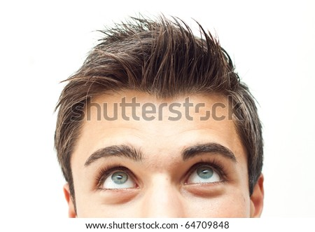 Young man looking up - stock photo