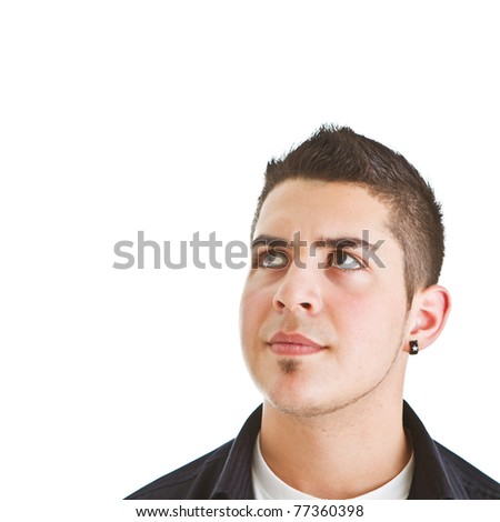 Young man looking up into open space. Isolated over white background.