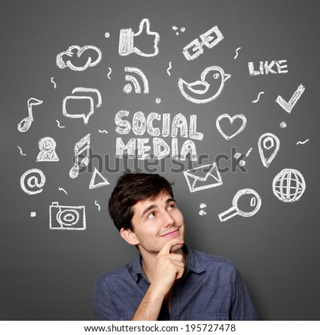 Young man looking up of Hand drawn illustration of social media sign and symbol doodles concept Foto stock ©