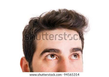 Young man looking up on white background #94565314