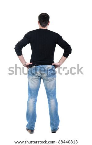 young man looks ahead. rear view. Isolated over white .