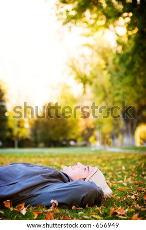 Young man loving the fall outdoors