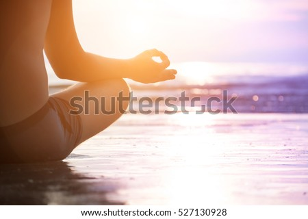 Young man make meditation in lotus pose, yoga and wellness concept. #527130928