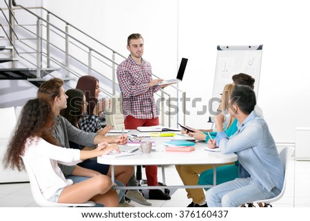 Young man making a presentation with laptop in the office #376160437