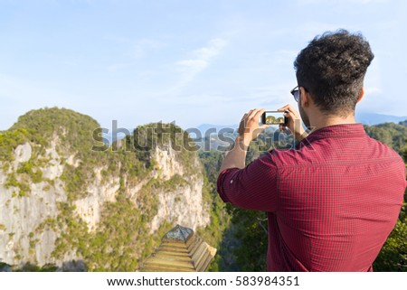 Young Man Mountains Take Photo Of Landscape On Cell Smart Phone Asian Holiday Summer Vacation Travel