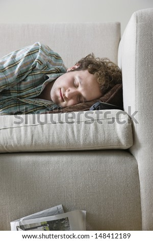 Young man napping on sofa